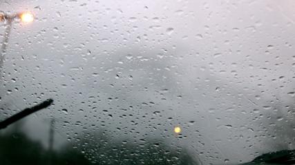 Windscreen wiper wiping rain away from car window