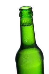 Cold beer bottle with dew drops