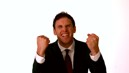 Businessman cheering on white background