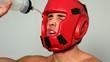 Tough boxer pouring water over his face