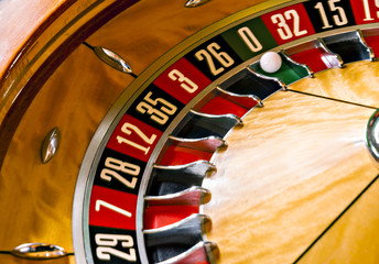 Roulette wheel with ball at 0.