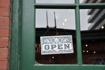 Open sign hang in the door