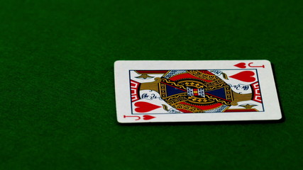 Jack of hearts falling on casino table