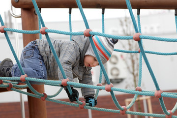 Child climbing on rope