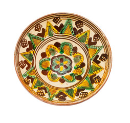 ancient plate from ceramics on a white background