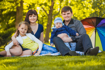 Happy family are plaing in the park