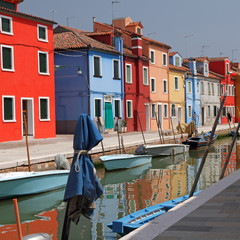 colorful houses on canal in Burano  village