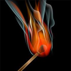 Burning match on black background
