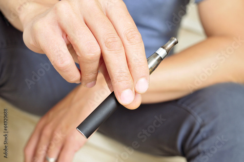 vaping with an electronic cigarette - 64920688