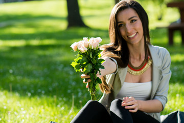 Beautiful Woman With Rose Flower Enjoying Nature