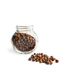Allspice in a glass bottle