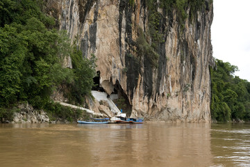 Pak Ou buddhist caves, boats waiting visitors - Laos