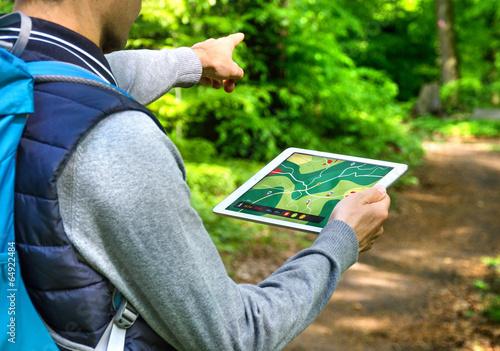Leinwanddruck Bild Man hiking with Tablet PC and GPS App – Wandern mit Wander App