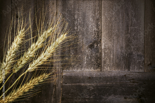 Wheats and Wooden Background - 64923823