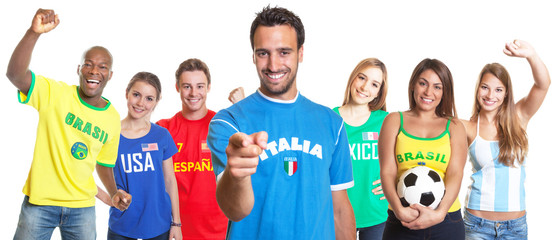 Italian football fan pointing at camera with other fans