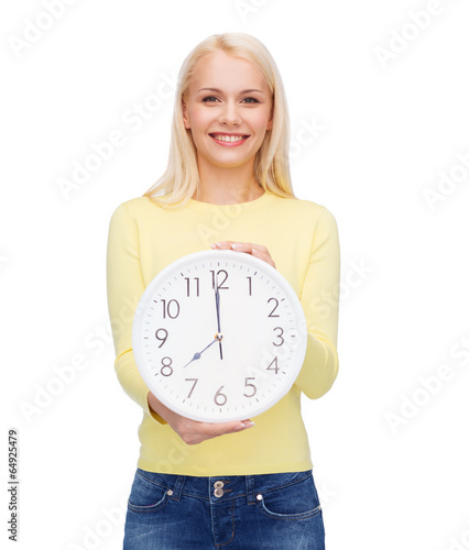 student with wall clock