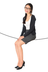 Asian woman sitting on a rope