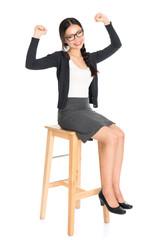 Asian girl sitting on a chair