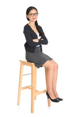 Asian female sitting on a chair
