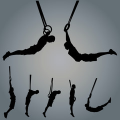 Sportsman silhouette with gymnastic rings