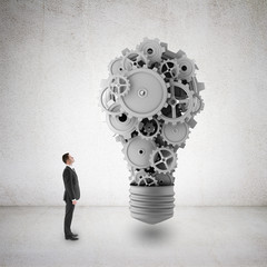 businessman  looking at gears