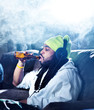 smoking marijuana and drinking beer amid clouds of smoke
