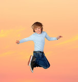 Adorable preteen boy jumping