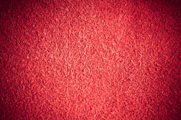 Red textured leather skin grunge background closeup