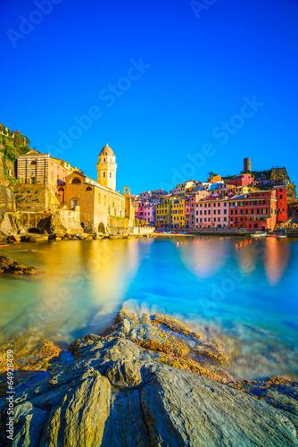 Vernazza village, church, rocks and sea harbor on sunset. Cinque - 64928499