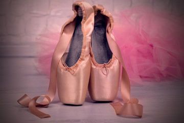 Ballet pointe shoes on floor