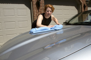 Woman Waxing Car