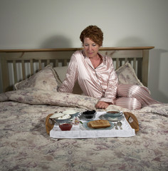Woman with Breakfast in Bed