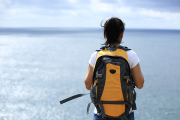 woman hiker enjoy the view at  seaside