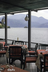 Restaurant dehor over the lake Maggiore color image