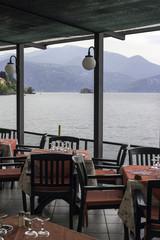Restaurant dehor over the lake Maggiore color image