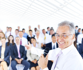 Cheerful Businessman Standing in front of the Audience
