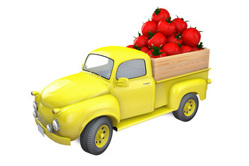 Yellow lorry with red tomatoes