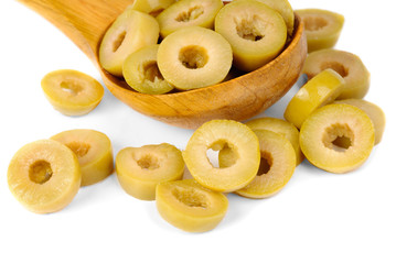 sliced green olives and wooden spoon isolated on the white