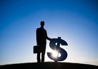 Businessman holding Dollar sign