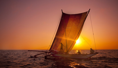 Sailing on a Catamaran at Sunset