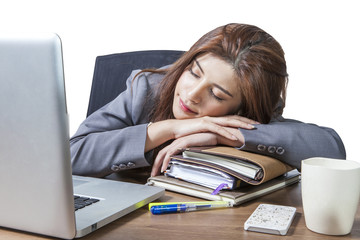 Young business woman sleeping at workplace