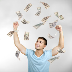 Happy man enjoying rain of money