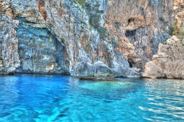 blue water by the cave