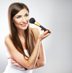 Beautiful smiling woman face. Make up applying with brush.