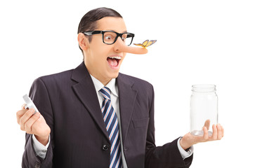 Businessman with butterfly on his nose holding a jar