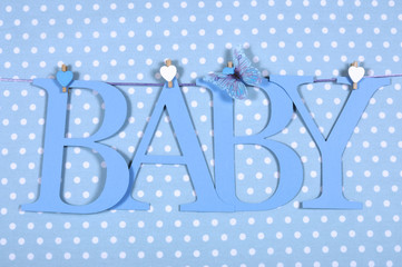 Baby boy letters bunting hanging from pegs on a line