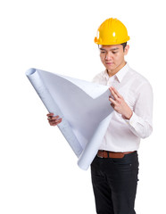 Asia construction engineer reading on blueprint