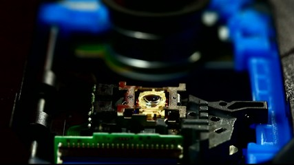 CD-ROM drive head moving and lighting laser to find the disk