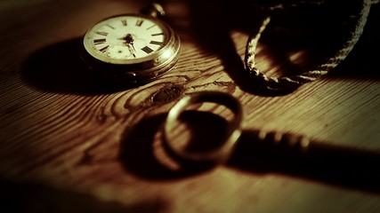 Close up of old table with turnip watch.