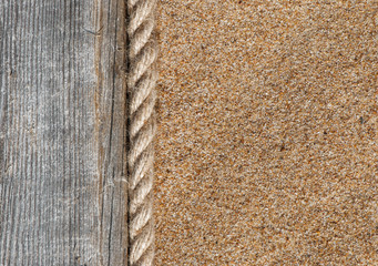 Sand background with old wood and rope